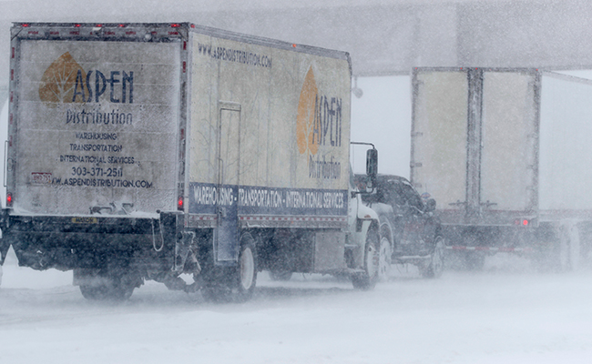 Vehicles stack up on I-70 in Aurora Colo
